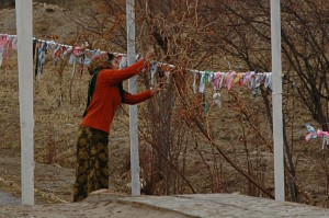 Shamanic traditional: hangig up strips of clothing for wishes
