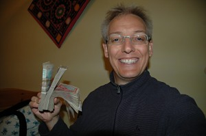 Rich man: how much money do I hold in my hand? Hint: there are 320 bank notes