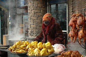 Market in Hotan: Chicken sales right in front of the mosque