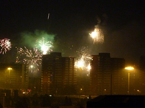 Fireworks between the tall buildings of  Beijing