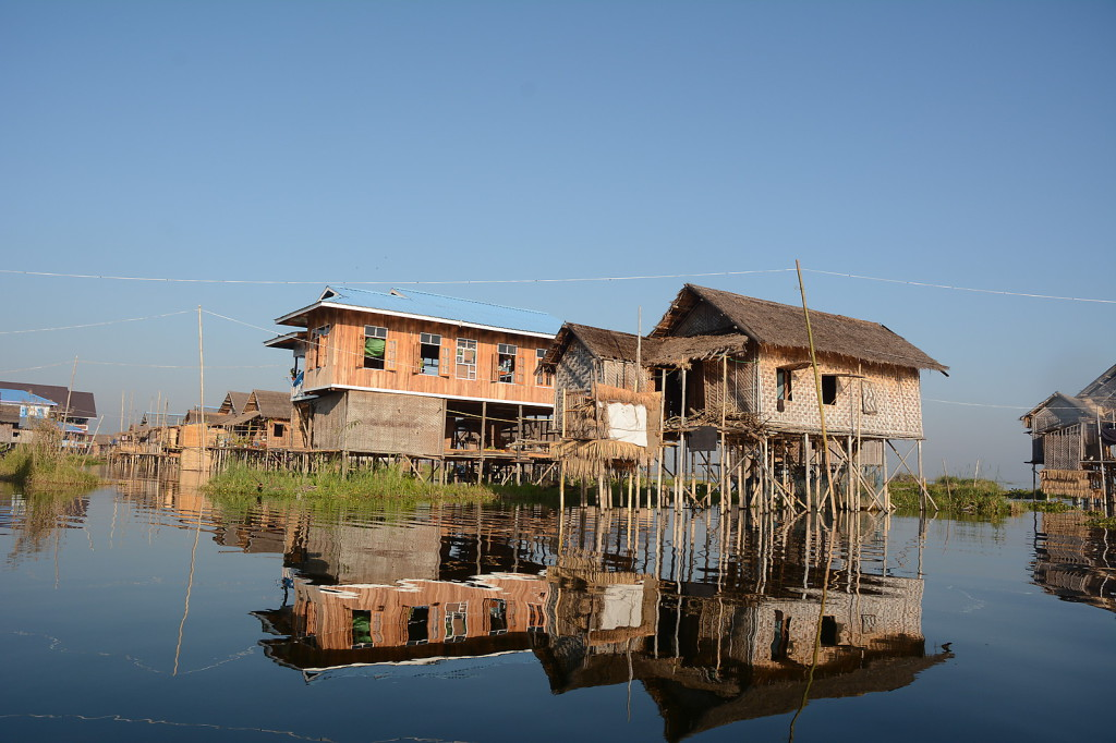 The villages on Inle Lake are all built in stilts. Children learn to paddle instead of walking