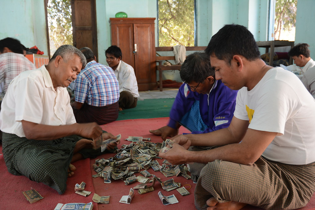 Counting donated money in Bagan