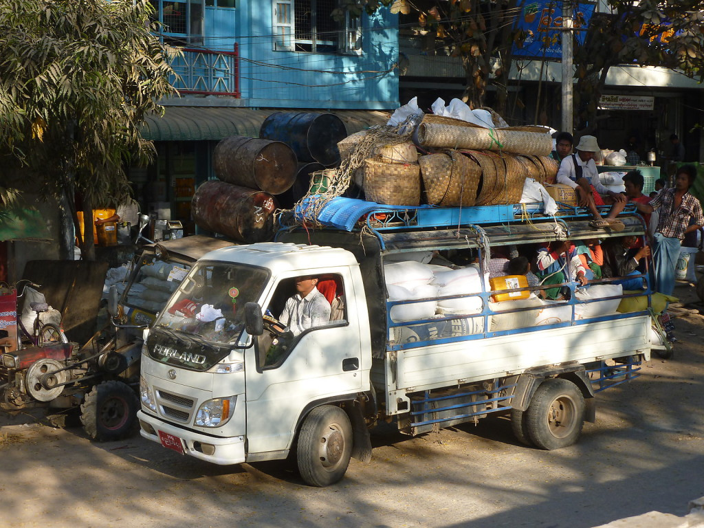 Typical Myanmar transport concept from front to back: driver, goods, people