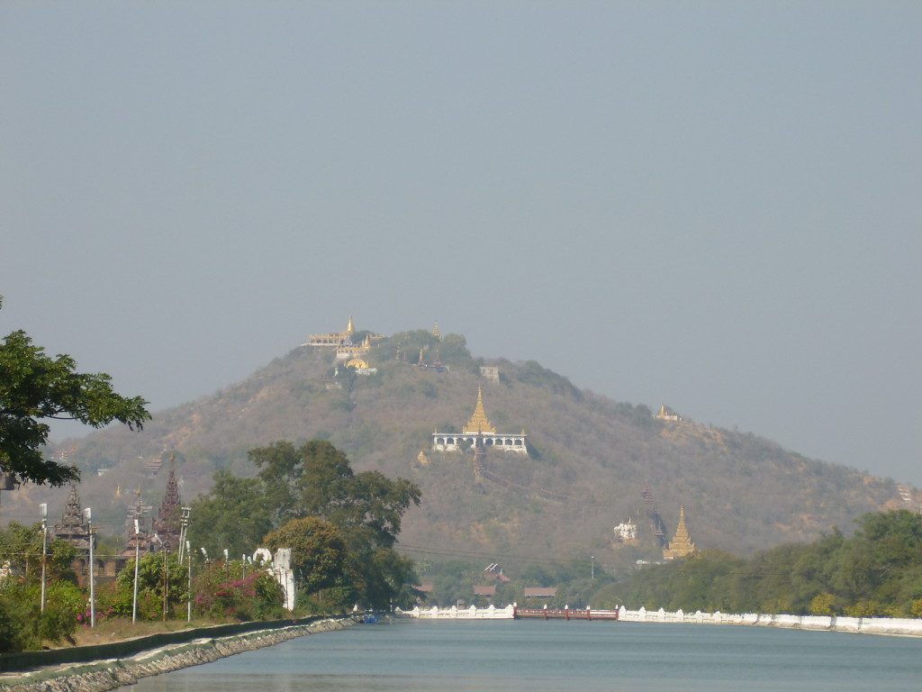 The palace moat with Mandalay hill in the background