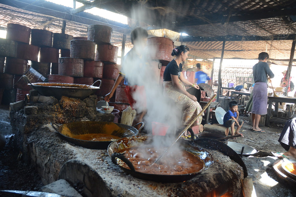 The first step in making sugar candy: boiling up the juice from sugar cane
