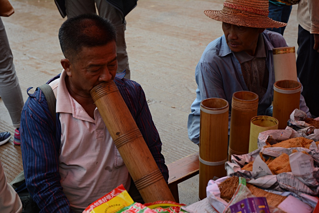 Testing tobacco at the Laomeng market