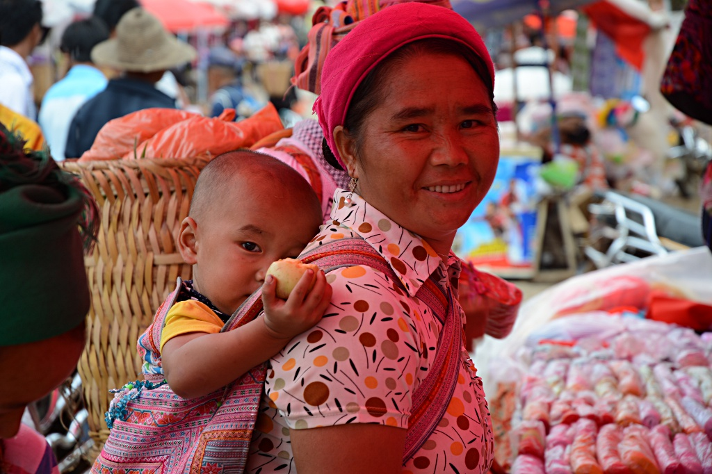 Traditional clothing and traditional way to carry a baby
