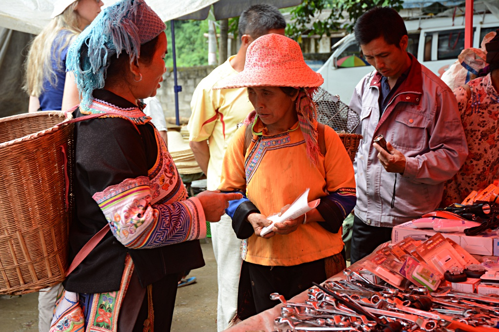 People from different minorities meet to do business in Laomeng