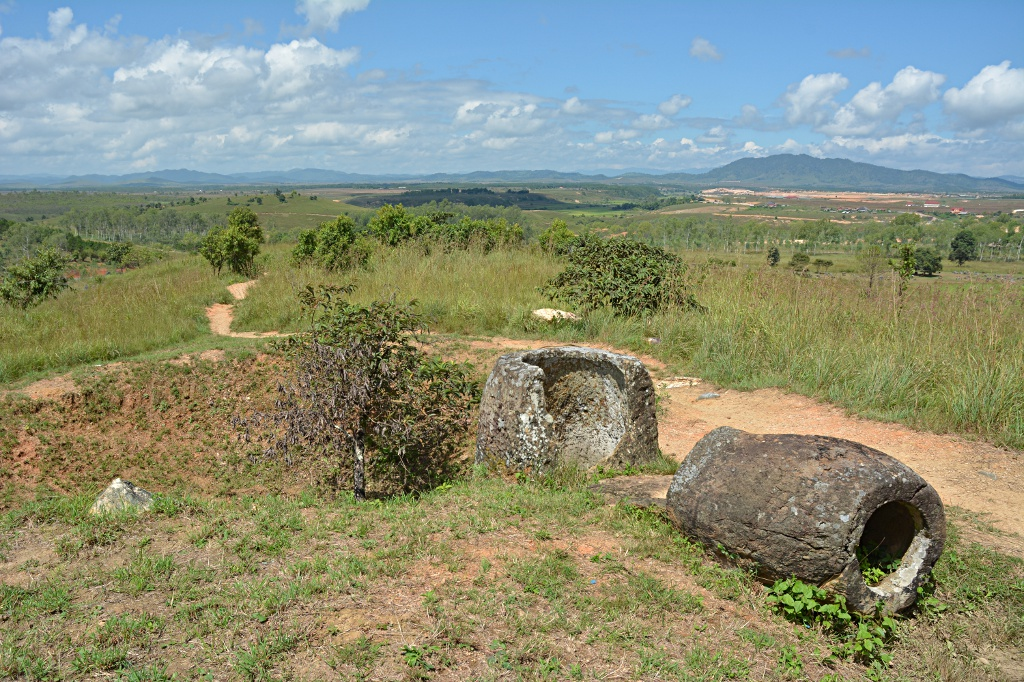 Ancient and recent history side by side: bomb crater and broken jars
