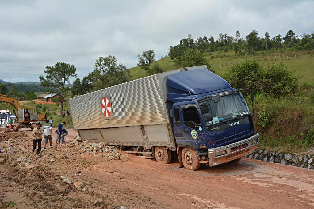 Bad luck: While the truck remained stuck in the mud, the makeshift road is taking shape