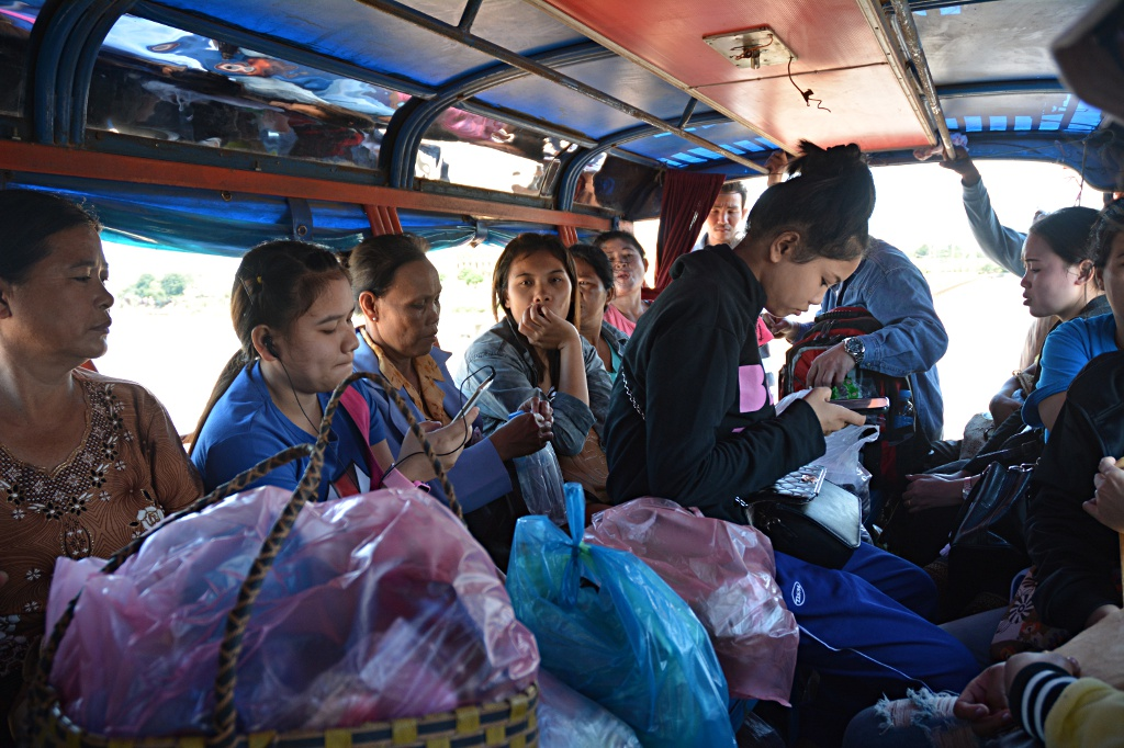 Fully loaded songthaew on the way from Pakse market to Champasak