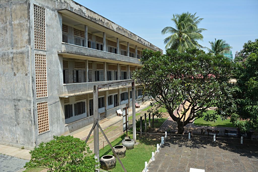 Tuol Sleng cell block (former class rooms) with torture (sports) equipment in foreground