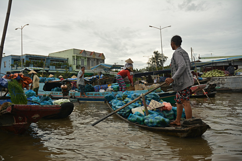 Busy floating market in Nga Nam