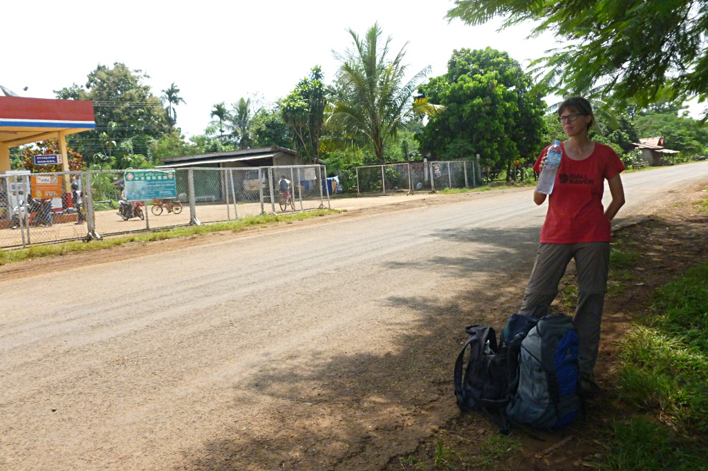 Lao bus station: anywhere where you can put your backpack to next to the road