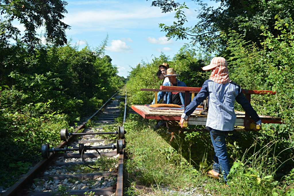 Creative tinkering, dis- and reassembling a bamboo train when crossing